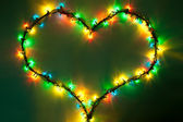 Shining heart on dark green background. Valentine's Day — Stock Photo