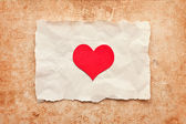 Ripped piece of paper on grunge paper background. vintage retro — Stock Photo