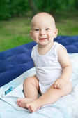 Smiling happy baby boy on picnic in summer — Stock Photo