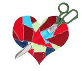Fabric scraps heart with scissors — Stock Photo