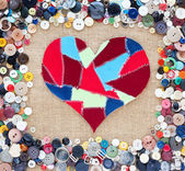 Fabric scraps heart on texture background. Valentine's Day. Butt — Stockfoto