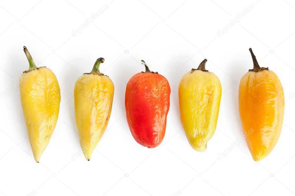 Five pepper with wrinkles isolated on white background, different concepts - one red pepper apple between four yellow  Stock Photo #6478721