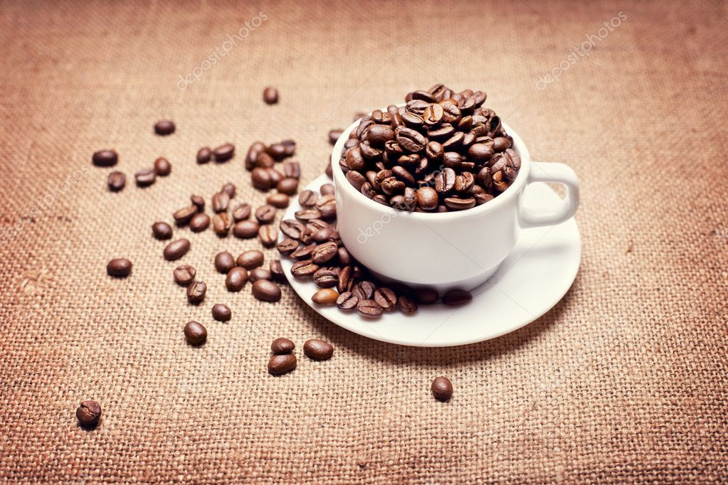 Cup with coffee beans on Coffee Beans And Cup Background
