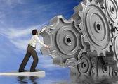Zakenman draaien een versnelling — Stockfoto