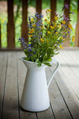Summer bouquet in a white pitcher — Stock Photo