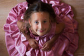 Smiling little girl in a pink dress — Stock Photo