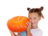 Girl with pumpkin on white background — Stock Photo