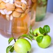Apples and cans of stewed apples — Stock Photo