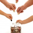 Hands of different generations saving coins — Stock Photo