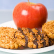 Cookies and apple for breakfast — Stock Photo