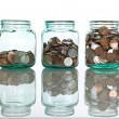 Glass jars with coins - savings concept — Stock Photo