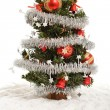 Small decorative christmas tree in artificial snow — Stock Photo