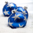Three blue christmas balls in snow — Stock Photo