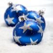 Three blue christmas balls in snow — Stock Photo