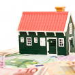 House on money field or foundation - isolated - Stock Photo