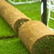 Royalty-Free Stock Photo: Turf grass rolls on football field