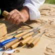 Постер, плакат: Traditional craftsman carving wood