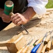 Traditional craftsman carving wood — Stock Photo