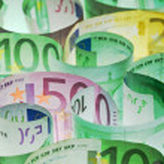 Money background - euro banknotes under lit — Stock Photo