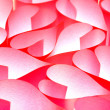Red paper hearts background — Stock Photo