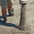 Pouring concrete - closeup - Stock Photo