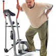 Man with back ache near a training device — Stock Photo #6409512