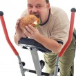 Man eating huge hamburger on a trainer device — Foto de Stock