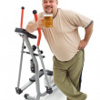 Overweight man having a beer after working out — Stock Photo