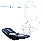 Phone splashing into water - high key — Stock Photo