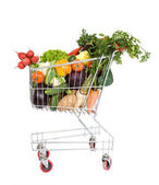 Shopping cart with vegetables — Stock Photo