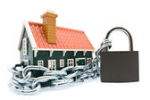 House in chains locked with padlock — Stock Photo