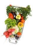 Shopping cart full of vegetables — Stock Photo
