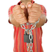 Man in chains - closeup, focus on hands — Stock Photo