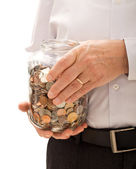Senior man hands holding jar with coins — Stock Photo