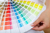 Woman hand with color sample — Stock Photo