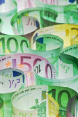 Money background - euro banknotes under lit — Stock Photo