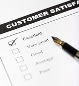 Customer satisfaction survey form with pen - closeup — Stok fotoğraf