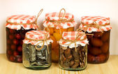 Canned goods on the shelf - savings concept — Stock Photo
