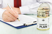 Financial plan concept with dollars — Stock Photo