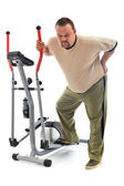 Man with back ache near a training device — Stock Photo