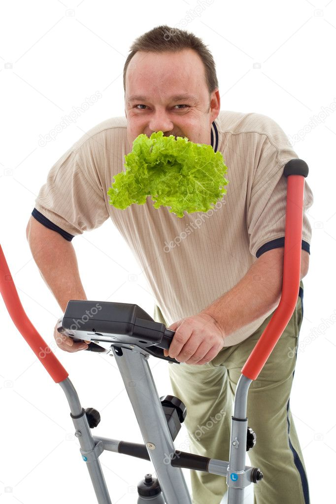 Power slimming concept with overweight man on exercise machine eating fresh green salad - isolated — Stock Photo #6409529
