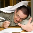 Meeting the deadline with paperwork - Stock Photo
