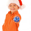 Boy with christmas bauble and santa hat - isolated — Stock Photo