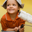 Happy painter with newspaper hat - Stock Photo