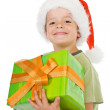 Happy smiling boy with christmas present - Stock Photo