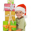 Happy boy at christmas with lots of presents — Stock Photo #6410465
