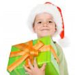 Proud little boy with christmas present - Stock Photo