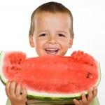 Happy boy eating watermelon — Stock Photo