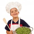 Happy chef with lots of fresh green peas — Stock Photo