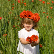 Little girl on the green wheat field with poppies — Stock Photo #6411102